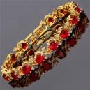 Pulsera de tenis chapada en oro de 18K y zirconia color rojo rubí..