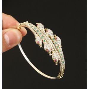Esmeraldas, rubíes y topacios. Brazalete en plata sólida de Ley contrastada 925 y bronce.