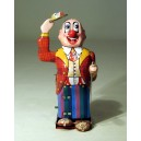 Mechanized clown with feet, eyes and arm in moviment. Tin toy
